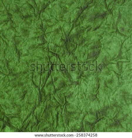 Green textured scrapbooking paper. Vintage background - stock photo