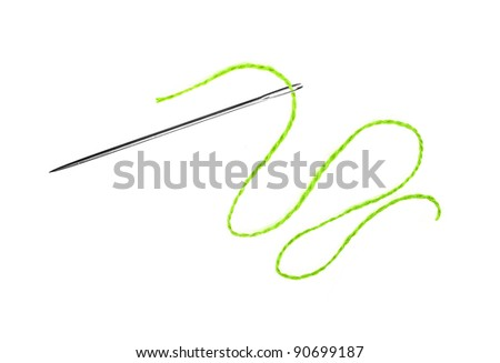 Green thread and needle isolated on white