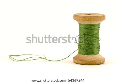 green thread spool , isolated on white background - stock photo