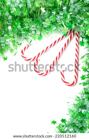 Green tinsel with candy canes decoration - stock photo
