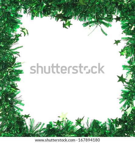 Green tinsel with stars as frame. Whole background. - stock photo
