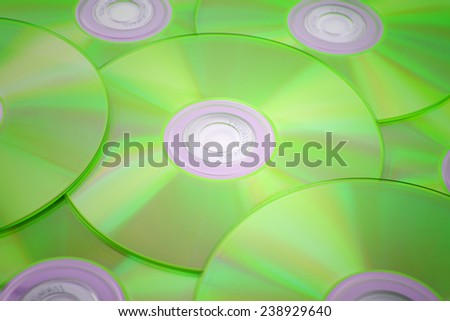 green tinted close-up of a stack of cd-roms - stock photo