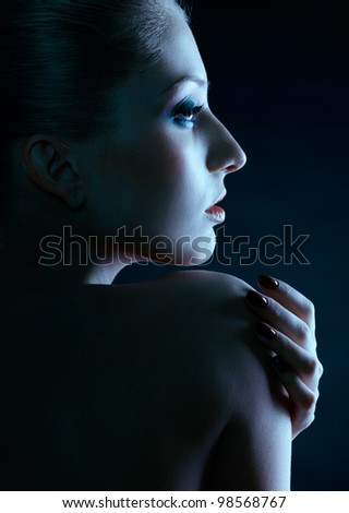 green tinted portrait of beautiful young blonde woman in ear-rings