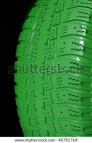 Green Tire on black background - stock photo