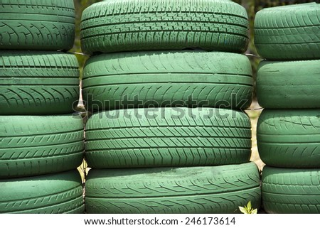 Green tires on a stack