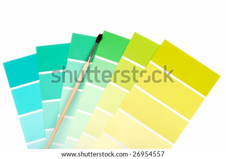 green to blue color chips with paint brush - stock photo