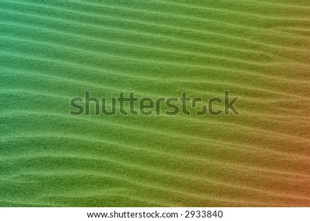 Green to orange colored wavy sand background