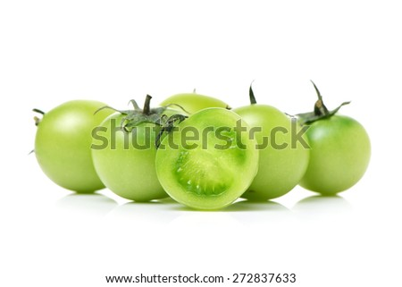 Green tomatoes on white background