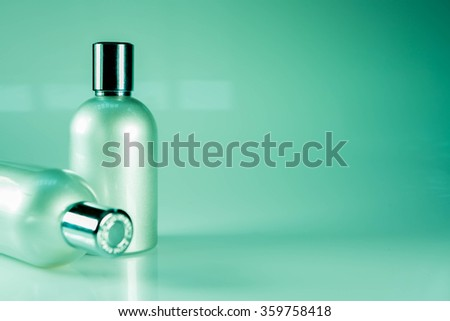 Green Tone and Side View : Two aluminum bottles - stock photo