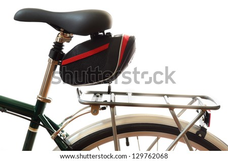 Green touring bicycle saddle and pannier rack isolated on a white background - stock photo