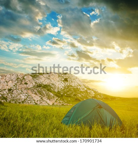 green touristic tent in a mountains - stock photo