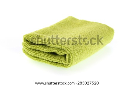 green towel rolls isolated on white background.
