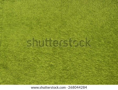 Green towel texture as background like grass  - stock photo