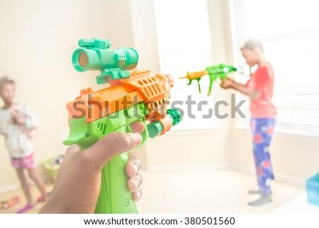 Green Toy gun shooting - stock photo