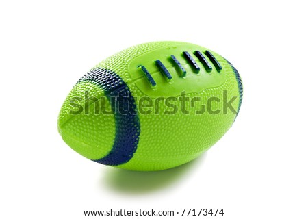 Green toy rugby ball isolated on white - stock photo