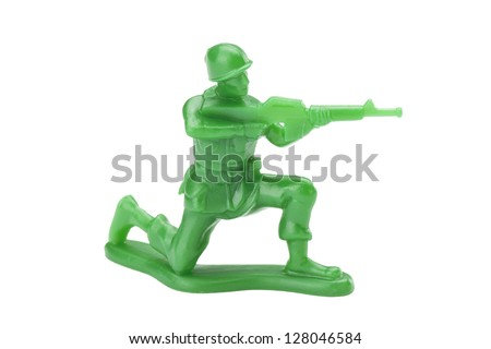 Green toy soldier isolated in a white background - stock photo