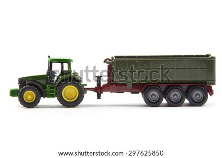green tractor with semi-trailer isolated over white background - stock photo