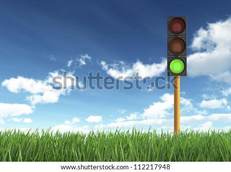 Green Traffic Light against Blue Sky Background - stock photo