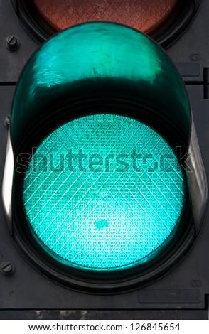 Green traffic light in full frame - stock photo