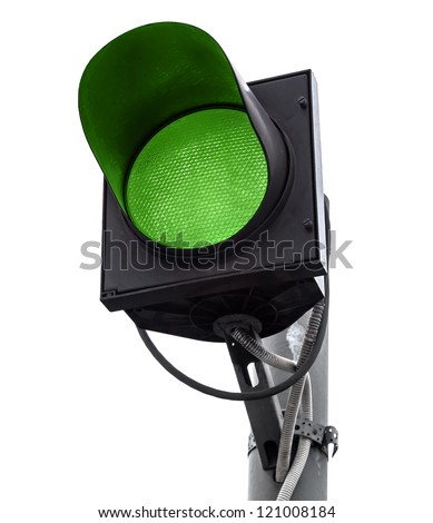 Green traffic light isolated on white - stock photo