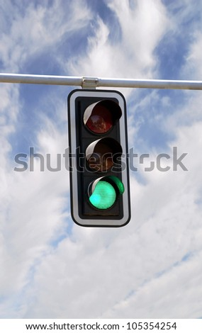 Green traffic lights against blue sky backgrounds with clipping path - stock photo