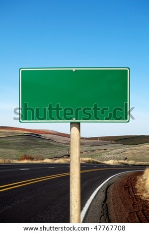 Green traffic sign curve road on background