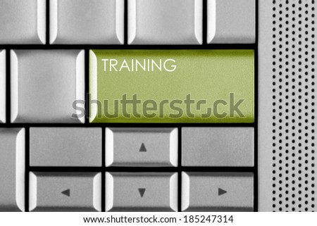 Green TRAINING key on a computer keyboard - stock photo