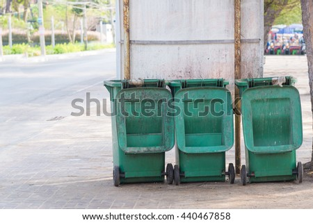 Green trash bin near the beach in Thailand - stock photo