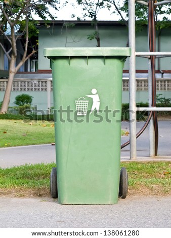 Green trash can in the park - stock photo