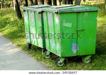 green trash cans in the woods - stock photo