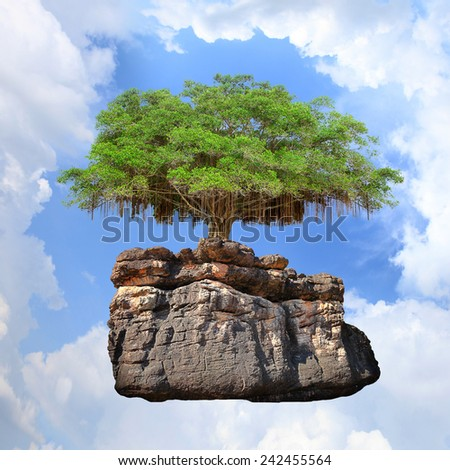 Green trees on a stone meteorite emerging new star floating on blue sky new hope. - stock photo