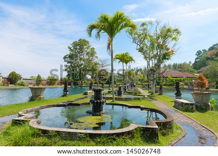 Green tropical park with fountains and ponds, Tirtaganga, Bali - stock photo