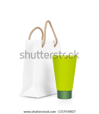 Green tube of cream gel with a plastic bag on a white background.