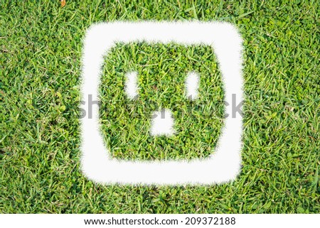 Green turf logo power outlet made of green grass - stock photo