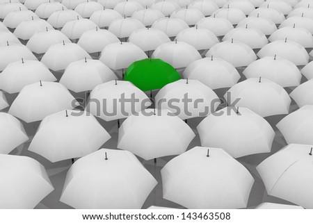 Green umbrella among other white umbrellas - stock photo