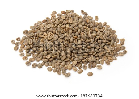 Green unroasted Arabica coffee beans isolated on a white studio background.