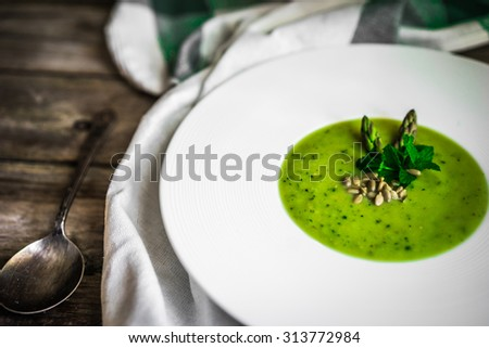 Green vegetable cream soup - stock photo