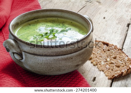 green vegetable cream soup with broccoli, rucola and spinach in a ...