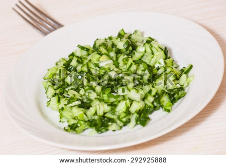 Green vegetable salad of cucumbers, spring onion