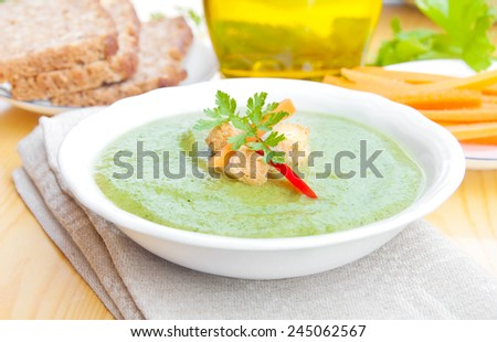 Green vegetable soup in a White bowl