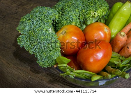 green vegetables on wood background