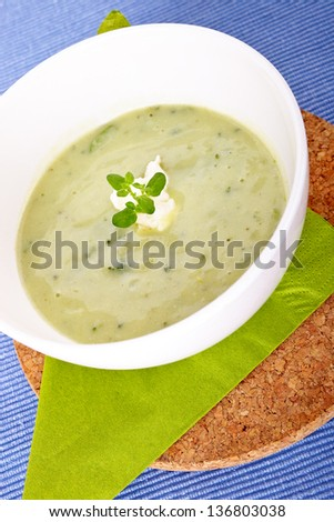 Green vegetale soup in a white bowl
