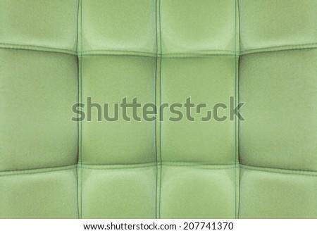 Green Velvet leather texture from sofa - stock photo