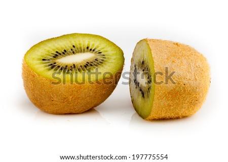 Green vibrant kiwi  half section - stock photo