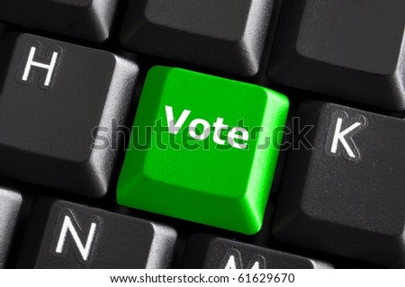 green vote button on computer keyboard showing internet concept - stock photo