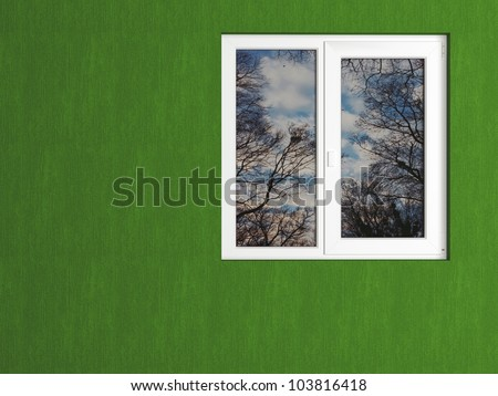 Green wall and white window reflecting the nature. House exterior. - stock photo