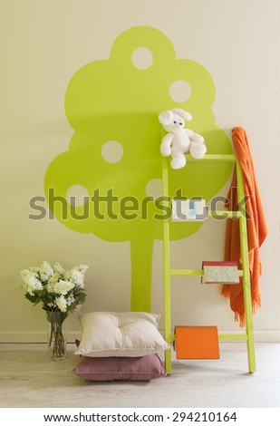 green wall baby room decor  pillow and stairs - stock photo