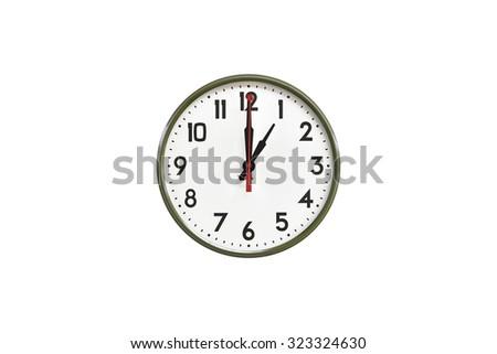 Green wall clock.One o'clock - stock photo