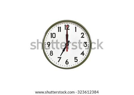 Green wall clock.Seven clock - stock photo