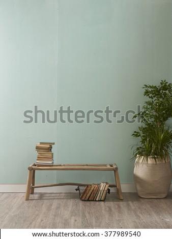 green wall desk and wooden floor interior decor - stock photo